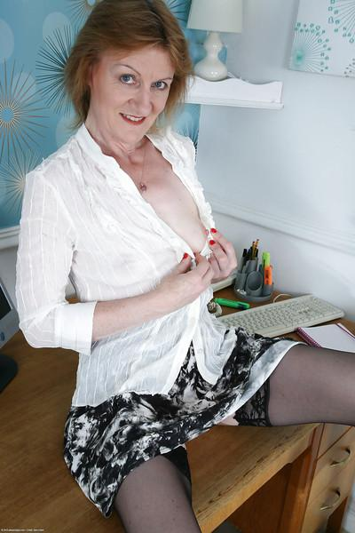 Upskirt scene with fantastic secretary Clare Cream in sexy stockings