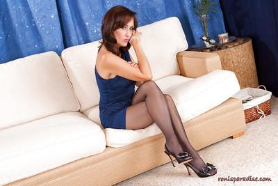 Long legged mature Roni strips and masturbates through pantyhose