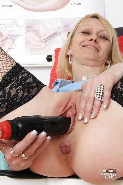 Mature blond nurse Nelly spreading her shaved pink pussy in hospital