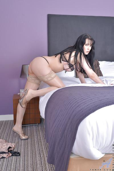 Brunette mature Tanya Cox has her long legs revealed in close up
