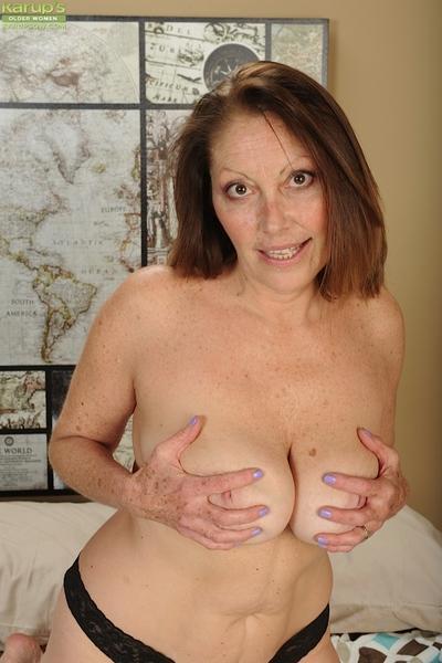 Older broad Jane McWilliams enjoying a smoke while fondling big boobs