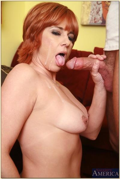 Redheaded mature lady fucks throbbing cock with her shaved pussy