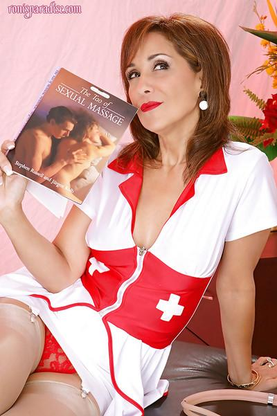 Skillful nurse Roni posing in stockings and massing her sexy client
