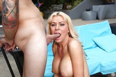 Blonde Sasha Sean gives a great deep blowjob and swallows sperm