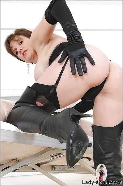 Mature femdom in high-heeled boots pleasing her masked male pet