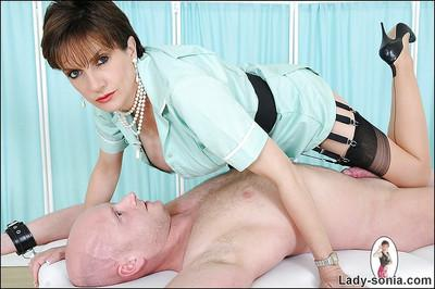 Kinky mature lady in stockings gives a handjob to a bald guy