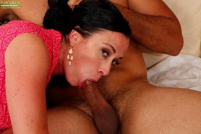 Older brunette Aerial Cruz giving blowjob on knees for cumshot in mouth