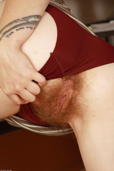 Hairy secretary Velma flashing panties and spreading incredible bush