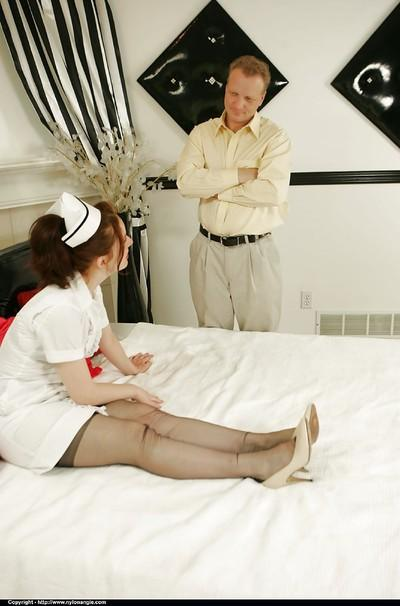 Sexy mature babe posing in nurse uniform and face sitting a kinky guy