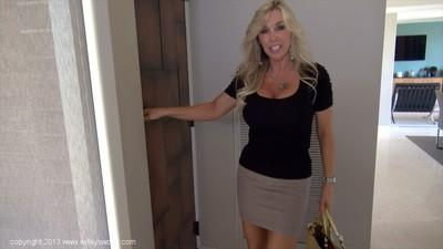 Fully clothed mature bombshell exposes her big tits covered with sexy bra