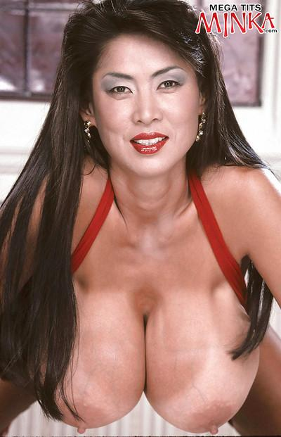 Mature Asian babe Minka flaunting monster tits and spreading hairy pussy