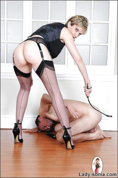 Barely clothed femdom in stockings has some fun with her male pet