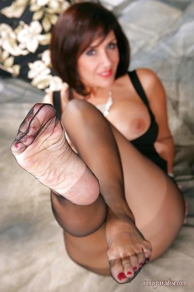 Lon legged mature Roni exposing her sexy feet wrapped in pantyhose
