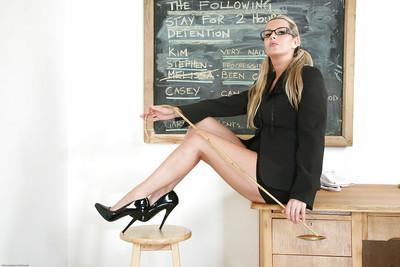 Stunning blonde teacher Jessica posing in a skirt and high heels