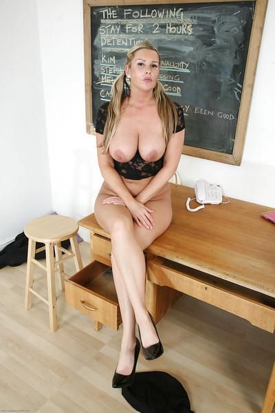 Stunning blonde teacher Jessica posing in a skirt and high heels