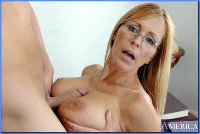 Mature teacher in glasses Nicole Moore pleasuring cock with her boobs
