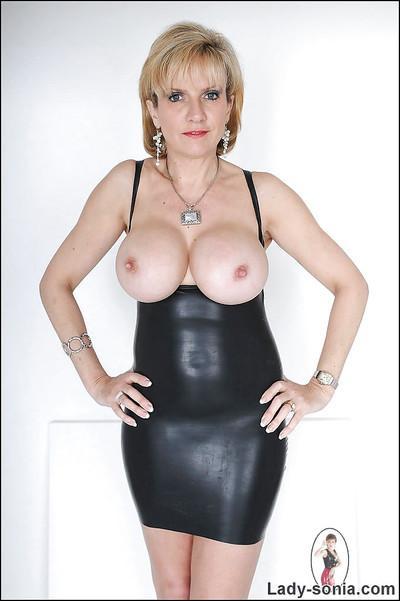 Fuckable mature blonde in latex dress revealing her big tatas