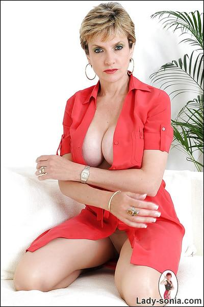 Sexy mature babe in red dress exposing her big tits with hard nipples