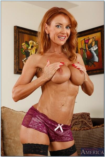 Classy mature teacher Janet Mason shows her big tits in sexy lingerie.