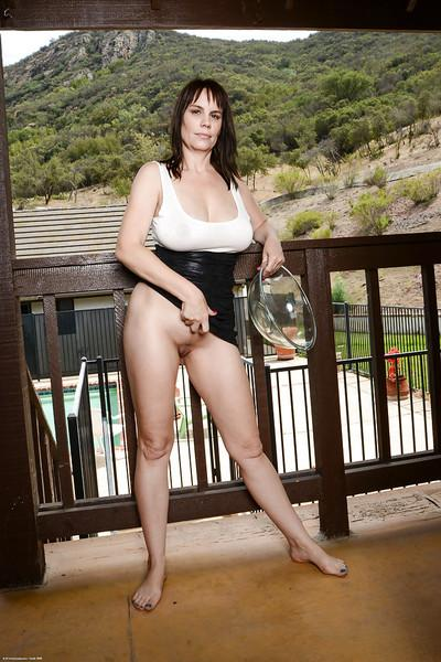 Close up posing scene with a marvelous brunette mature Kelly Capone
