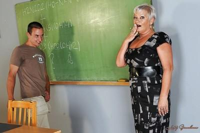 Buxom mature teacher with big tits gets banged by her student