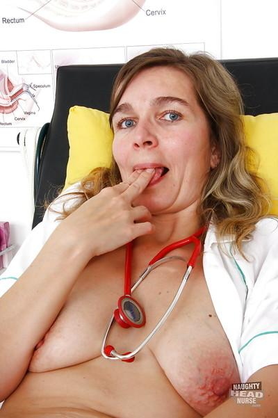 Chubby mature nurse in uniform toying twat during masturbation session
