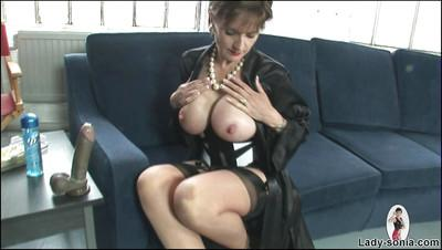 Stunning Lady Sonia showing big ass and playing with a huge dildo