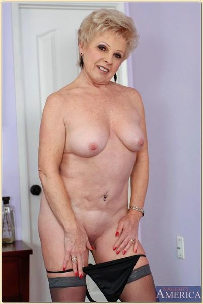 Older mom Mrs. Jewell denudes tits and poses in grey stockings