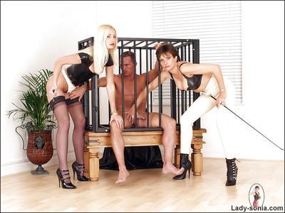 Kinky mature babes on high heels giving a footjob and tasting jizz