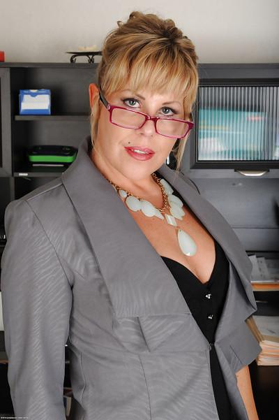 Glasses wearing blonde office worker Kayla Larson flaunting big tits