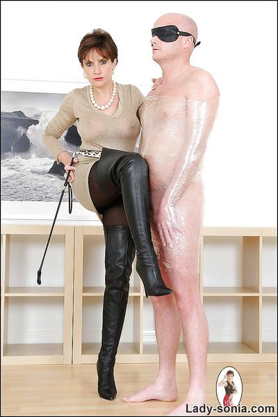 Lusty mature femdom tortures her blindfolded and overwrapped manslave