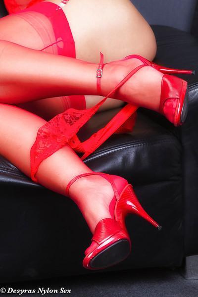 Mature European babe Desyra Noir pulling panties down around ankles