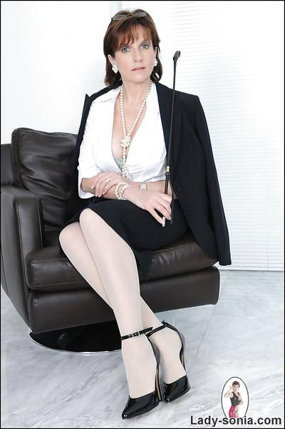 Lusty mature lady in formal suit and pantyhose revealing her big tits