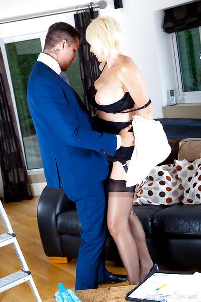 Experienced blonde cougar Jan Burton seduces younger man with upskirt view