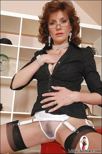 Mature fetish lady in glasses teasing her slit through her panties