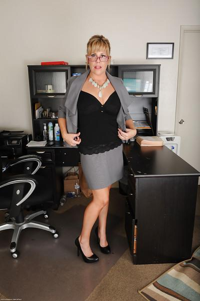 Blonde secretary Kayla Larson stripping naked at work place