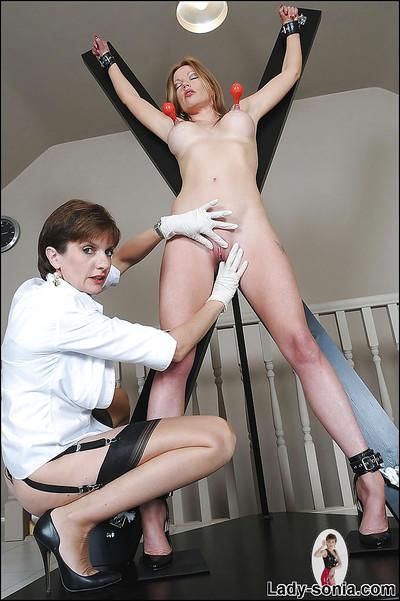 Horny mature lesbian pumps her bound friend