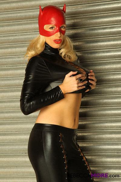 Kinky mature lady showed her big tits in very kinky latex outfit.