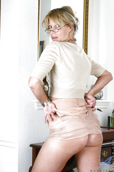 Mature secretary in glasses revealing aroused clit and small tits in the office