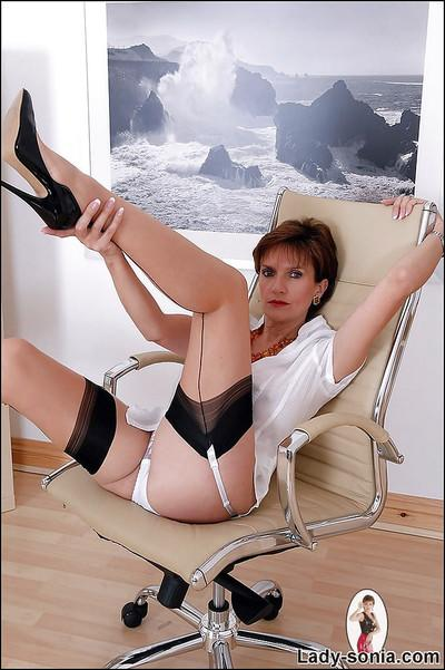 Hot mature lady spreading her legs and showing off her white panties