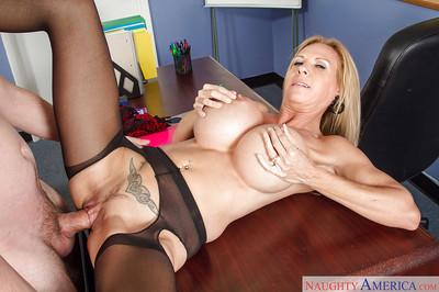 Mature teacher Brooke Tyler is giving a juicy deep blowjob on cam