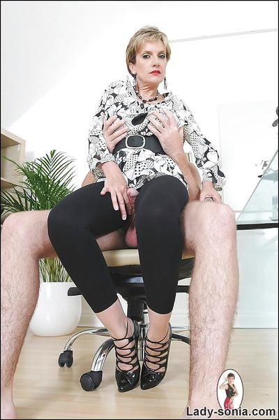 Fully clothed mature lady on high heels teasing a guy