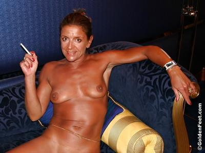 Aged solo model Lady Sarah having a drink and smoke after masturbation