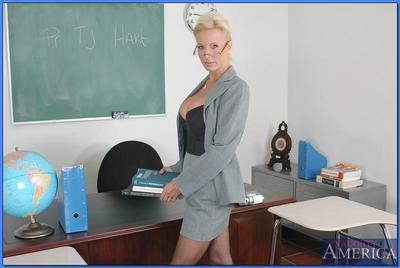 Mature teacher in glasses TJ Hart revealing smashing boobs and ass