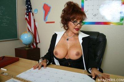 Big titted teacher Sexy Vanessa plays with her pussy in the classroom
