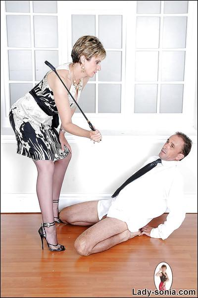 Sexy mature lady tortures a guy with her riding crop and high heels