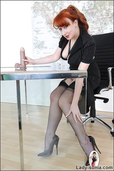 Lusty mature fetish lady in formal suit and stockings playing with big dildo