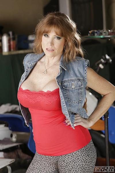 Mature pornstar Darla Crane gets nude and flaunts huge older lady boobs