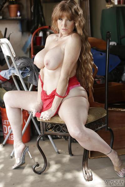 Mature pornstar Darla Crane gets nude and flaunts huge older lady boobs