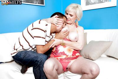 Older blonde Lola Lee getting her mature tits and butt groped and licked